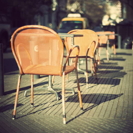 Chairs of an outdoors cafe photo