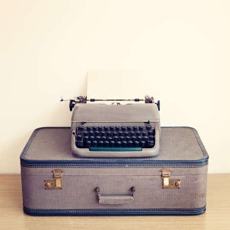 Typewriter over vintage suitcase photo