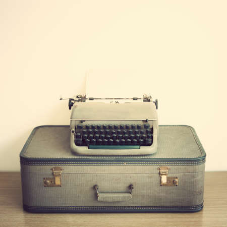 old suitcase: Typewriter over vintage suitcase Stock Photo