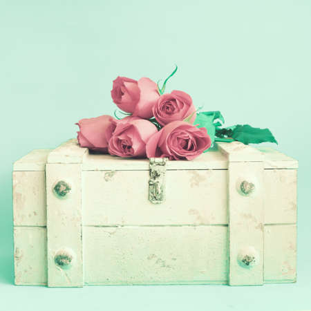 colorful still life: Wooden chest with roses