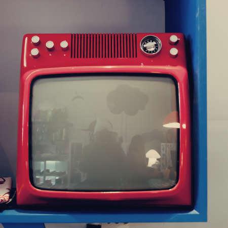 Vintage red TV set photo