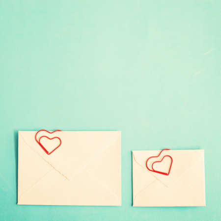 old envelope: Mail envelopes with heart-shaped clips