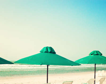 tend: Vintage summer beach with green umbrellas