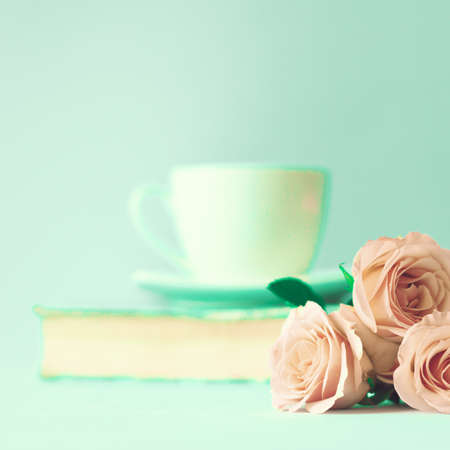 old backgrounds: Soft pink roses and tea cup Stock Photo