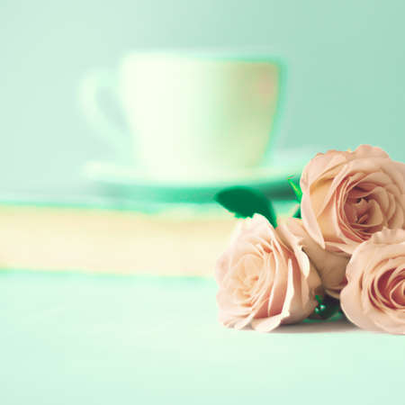 Roses and a tea cup photo