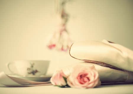 pointe: Ballet shoes, roses and a tea cup