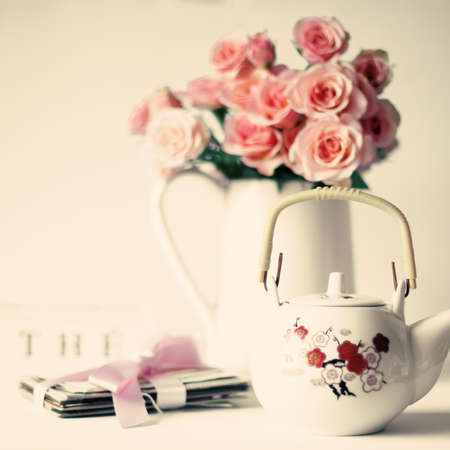 Bouquet of soft pink roses and japanese teapot photo