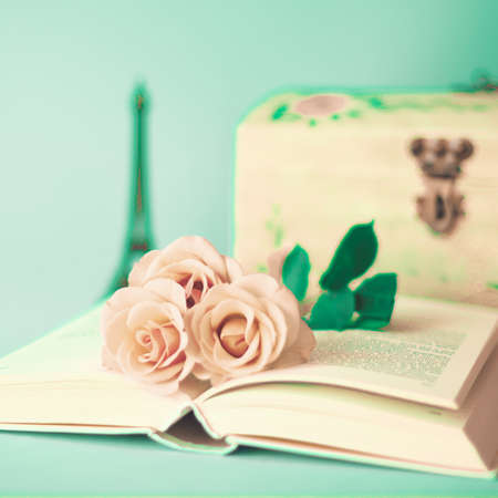 Roses over a vintage book photo