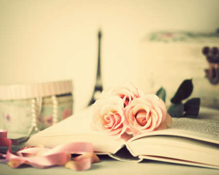Roses over a vintage book