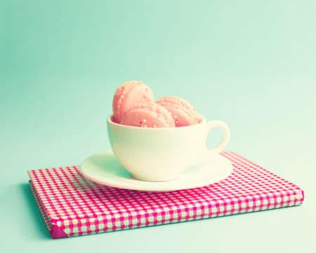 Macaroons in a coffee cup photo