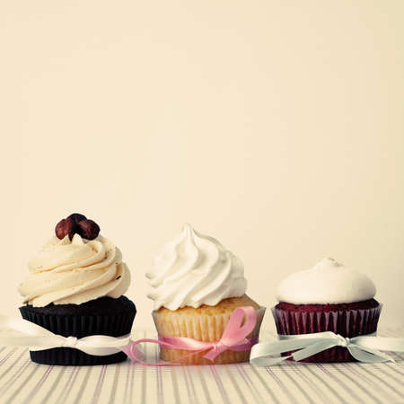 Three cupcakes over white background photo