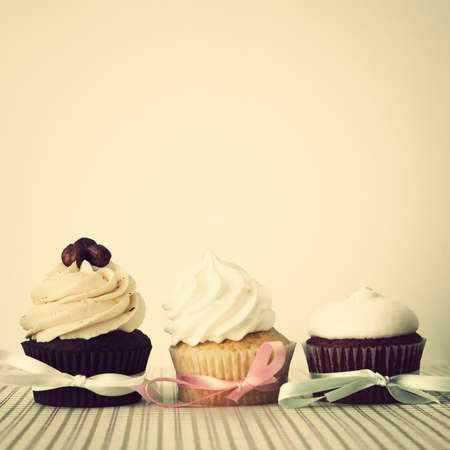 pink ribbons: Three cupcakes over white background Stock Photo