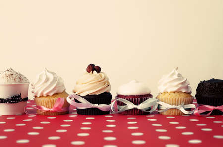 Six cupcakes over a polka dots tablecloth photo