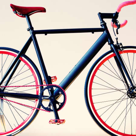 parked bicycles: Vintage black bicycle with red rims