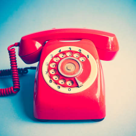 phone receiver: Vintage red telephone Stock Photo