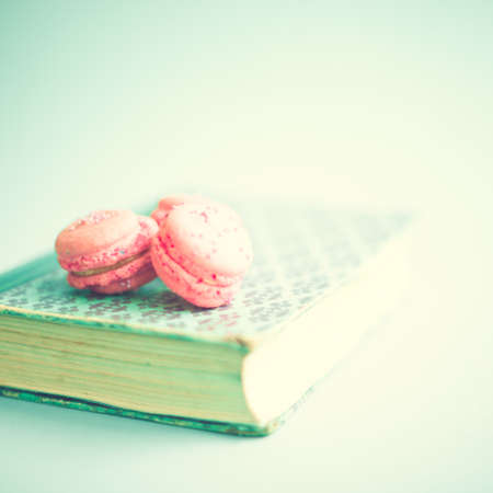 Pink macaroons over vintage book photo