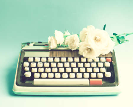 Vintage typewriter and roses