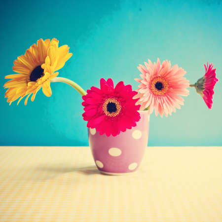 vintage colorful flowers on a polka dots vase photo