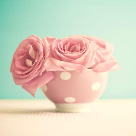 Vintage roses in a polka dots bowl photo