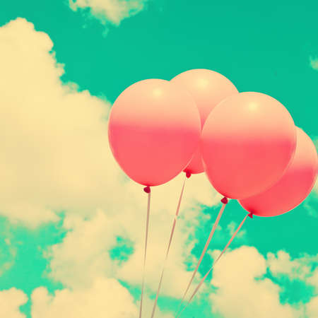 Four pink balloons