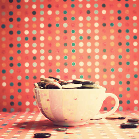 Vintage buttons in a tea cup photo
