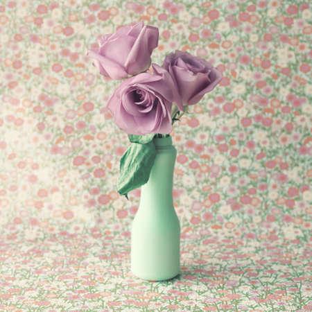 Roses in a vintage mint vase photo
