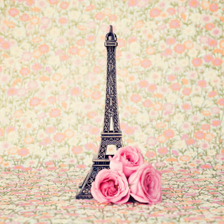 french perfume: Eiffel tower with pink roses Stock Photo
