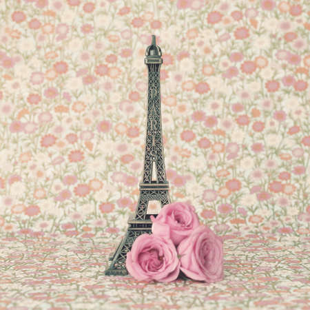 Eiffel tower with pink roses photo