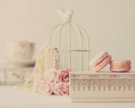 Vintage roses and pearls with macaroons over box photo