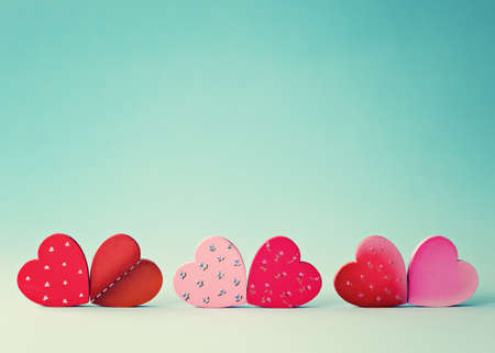 clothes pin: Six wood hand-painted hearts over blue background Stock Photo