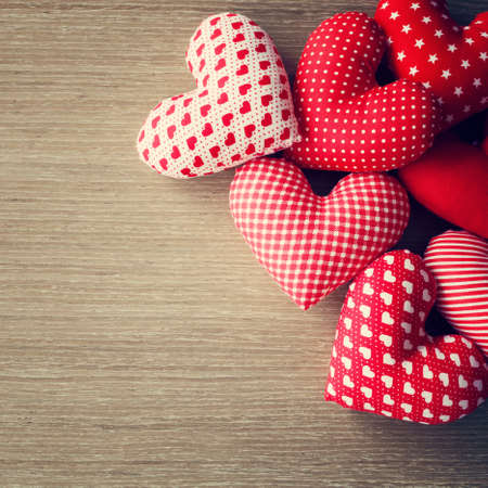 Stuffed cotton hearts over wood