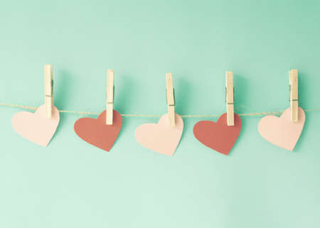 wedding wishes: Paper hearts hanging from clothespins Stock Photo