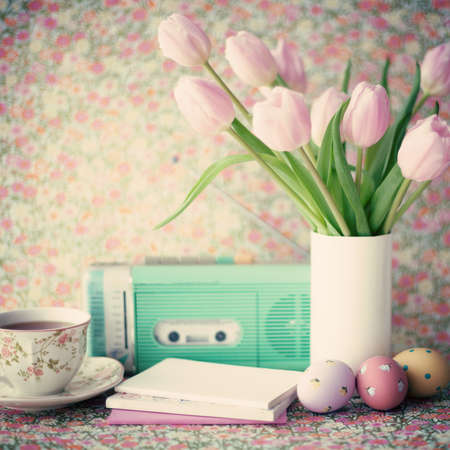 Pink tulips and vintage objects photo