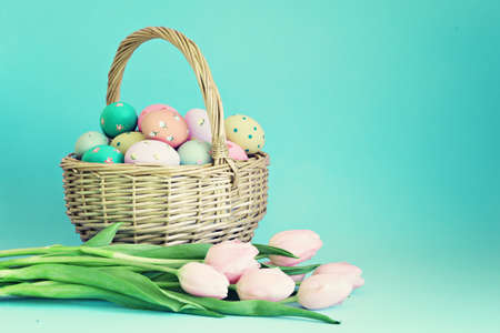 Vintage easter eggs in a basket and pink tuips
