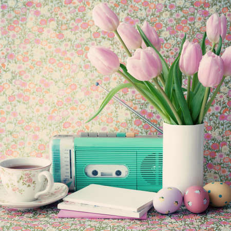 Pink tulips and easter eggs with vintage objects photo