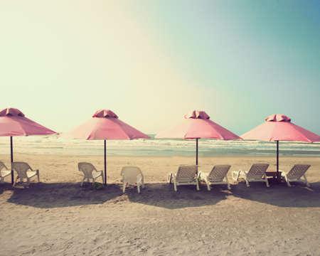 tend: Pink umbrellas in a summer beach Stock Photo