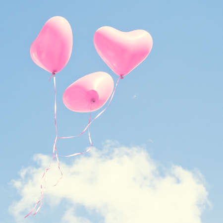 Drie roze hartvormige ballonnen
