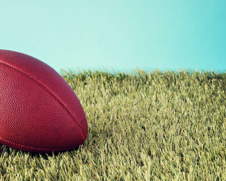 Vintage football over grass