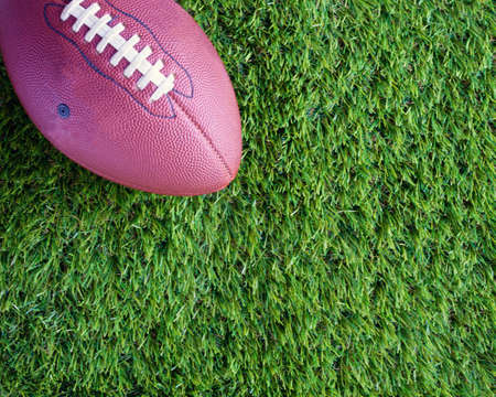 handoff: Football over grass Stock Photo