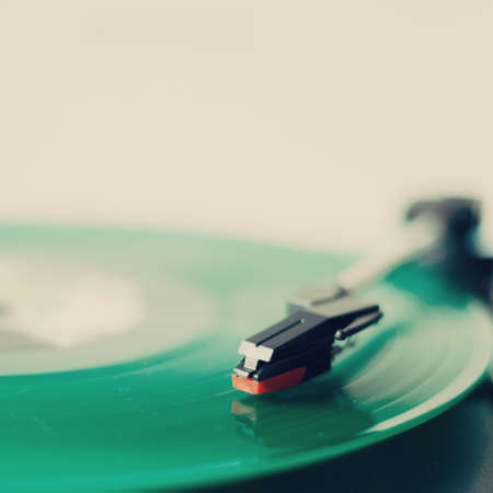 turntable: Green vinyl record in a turntable Stock Photo