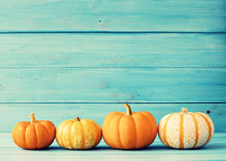 Pumpkins over turquoise wood