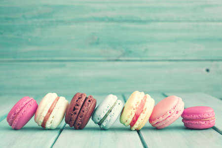 serenity: Colorful macaroons over turquoise wood Stock Photo