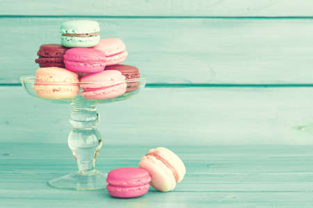 Colorful macaroons in a glass vase