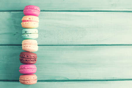 texture wallpaper: Colorful macaroons over turquoise wood Stock Photo