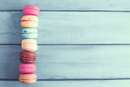 Colorful macaroons over turquoise wood Stock Photo