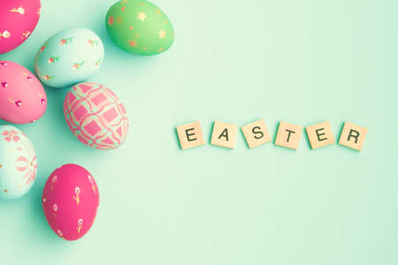 easter message: Vintage pastel easter eggs over mint background with Easter message in tiles