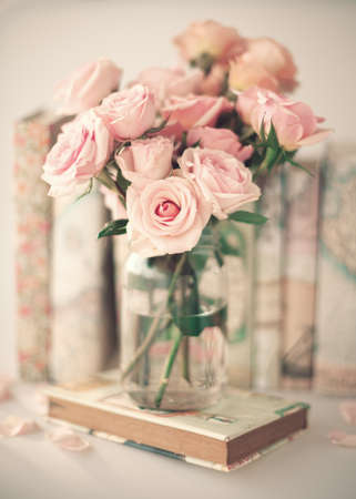 roses in vase: Roses in a crystal vase and vintage books Stock Photo