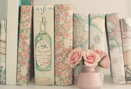 roses in vase: Vintage books and roses in a tiny pink vase