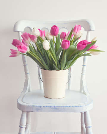 wallpaper vibrant: Pink and white tulips in a white tin bucket over a vintage wood chair