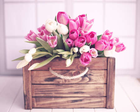 wood crate: Pink and white tulips over a vintage wood crate